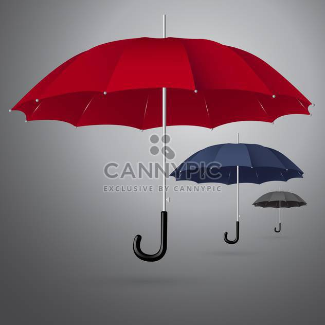 Vector set of three different sized umbrellas on gray background - Free vector #129871
