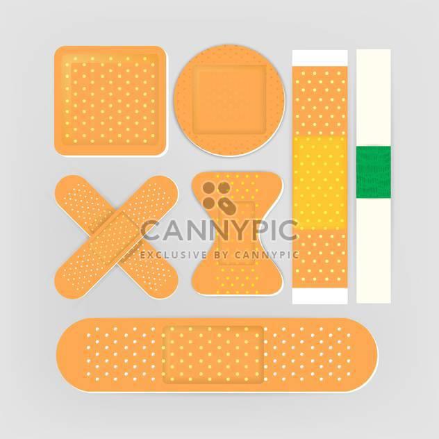 Adhesive bandages set on grey background - Free vector #131851