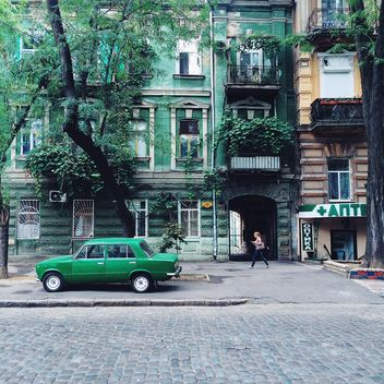 Architecture and green car in the street - бесплатный image #136221