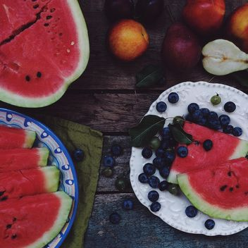 Summer fruits food-collage on a dark wooden table - бесплатный image #136251