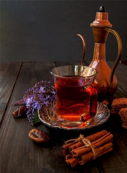 Cup of tea with cookies, cinnamon and dates - image #136681 gratis