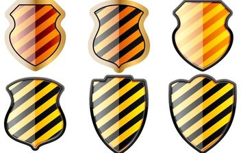 Free set of of shields in black and yellow stripes - vector gratuit #178301