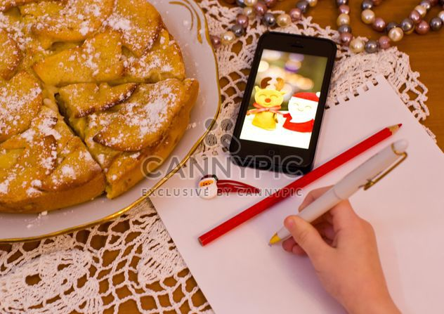 Apple pie and child writing on paper - Free image #182601