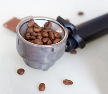 Coffee beans in portafilter - Free image #182671