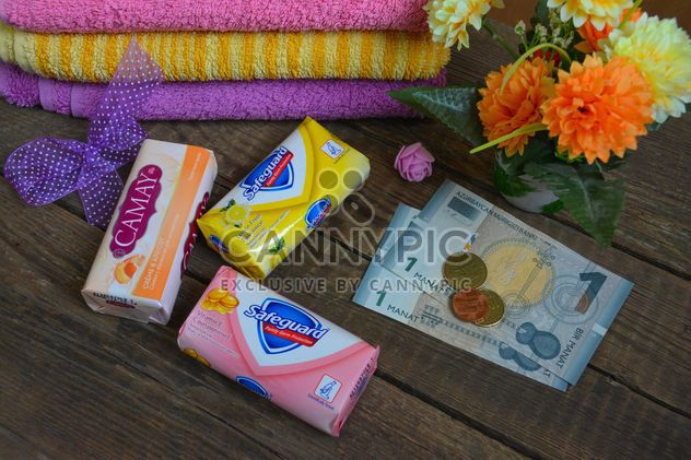 Bars of soap, towels, flowers and money - Free image #182801
