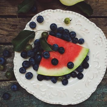 Slice of watermelon and blueberries - бесплатный image #183281