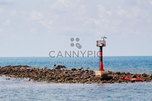 Lighthouse on rocks - Free image #183441