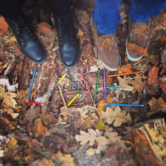 Couple of feet near word Love made of pencils on fallen leaves, #autumncity - Free image #183651