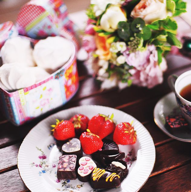 Strawberries and candies on plate - Free image #184091