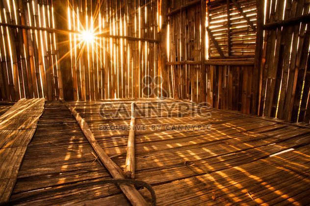 Sunlight pierces into bamboo hut - Free image #184281