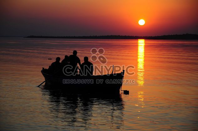 Fishing boat during sunset - Free image #185921
