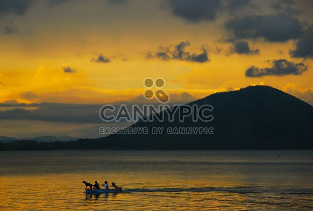 Sunset silhouette of kids in the boat - Free image #186431