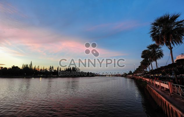 Sunset on river enbankment - Free image #186511