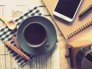 Cup of black coffee, smartphone and notebook on the table, vintage effect - image #187081 gratis