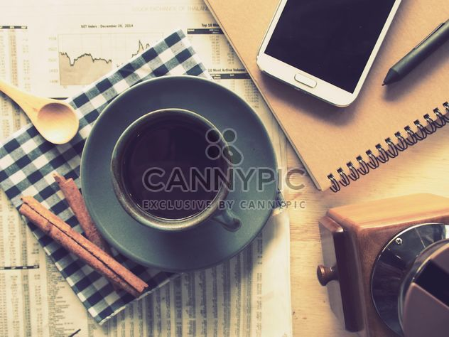 Cup of black coffee, smartphone and notebook on the table, vintage effect - Free image #187081