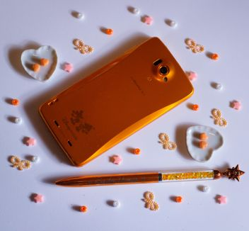 orange smartphone with little hearts and and bows - image gratuit #187231
