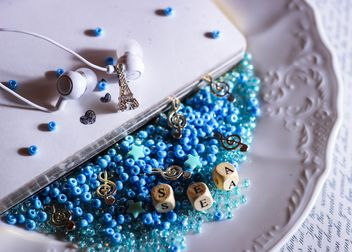 Blue beads in a plate - image #187301 gratis