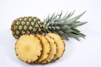 Whole and sliced pineapples on white background - image gratuit #187801