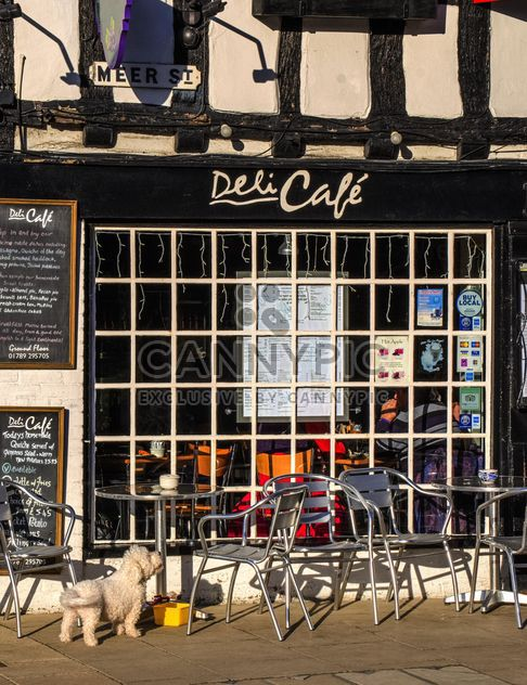 Facade of cafe and tables with chairs - Free image #198331