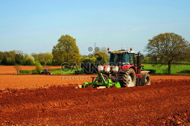 Tractor ploughing on farm - Free image #198351