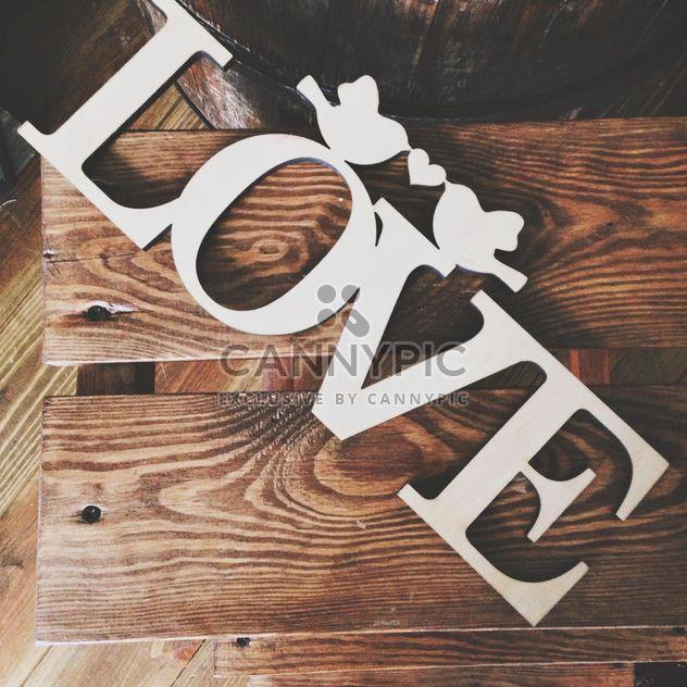 Знак любви на деревянных фоне - бесплатный image #198481