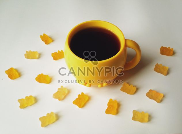 Cup of tea and jelly bears on white background - Free image #198731