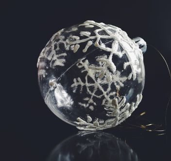 Transparent Christmas ball with snowflakes on a black background. - Free image #198811