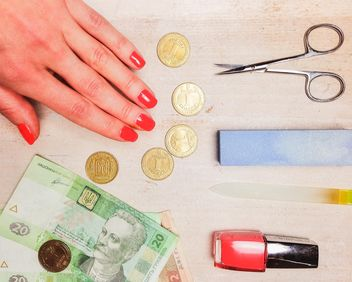 Female hand, money and accessories for manicure on wooden background - бесплатный image #198961
