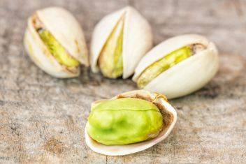 Pistachios on wooden background - image gratuit #271601