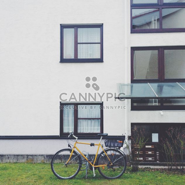 Yellow bicycle near building - Free image #271671