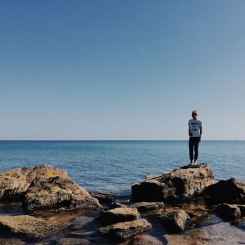 Girl on the stones in the sea - image gratuit #271691