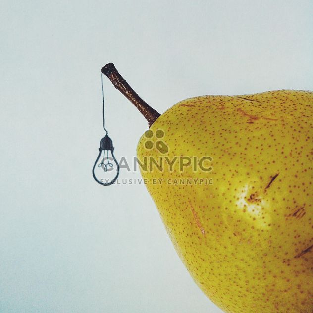 Pear and painted light bulb isolated on white background - Free image #272191