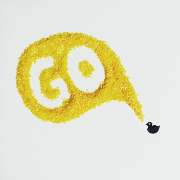Small painted duck with big yellow speech bubble on white background - image gratuit #272201