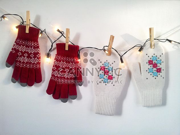 Woolen mittens hanging on rope with clothespins - Free image #272301