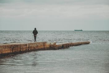 Man on the pier at the sea - бесплатный image #273761
