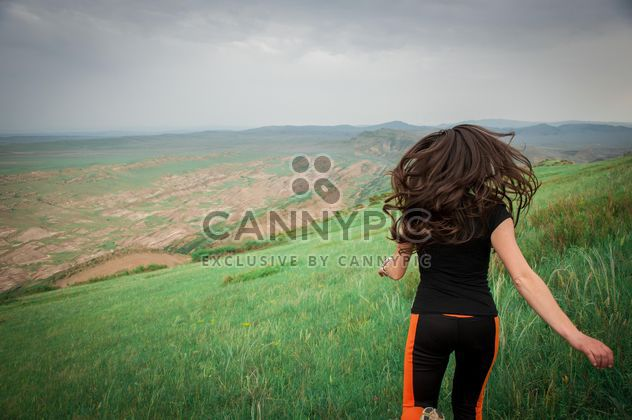 Girl running on green meadow - Free image #273831