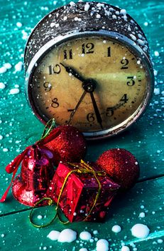 Christmas decorations and old clock on green wooden background - бесплатный image #302031