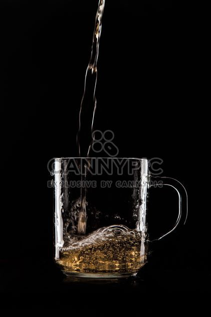 Copa de cristal sobre fondo negro - image #303221 gratis