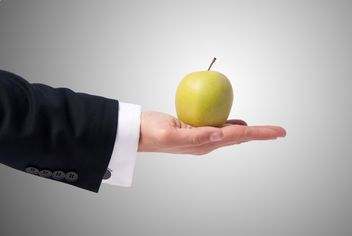Apple in man's hand - image #303331 gratis