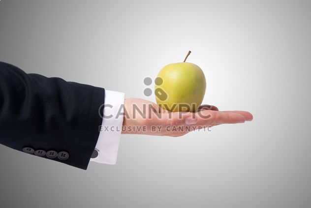 Apple in man's hand - Free image #303331