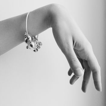 woman's hand with silver bracelet - бесплатный image #304101