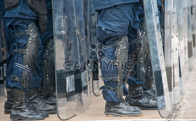 Policemen's legs in protective plates - Free image #304611