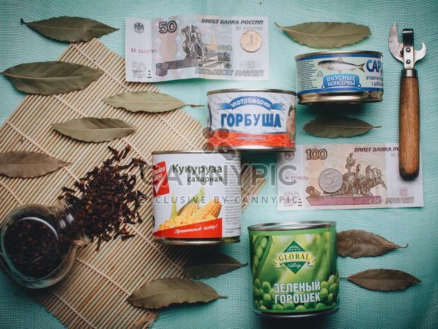 Tin cans and money - Free image #305391