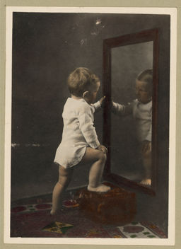 I sure am good looking in my pajamas ... Vintage Picture of a Cute Young Boy Looking at His Reflection in the Mirror - Free image #314151