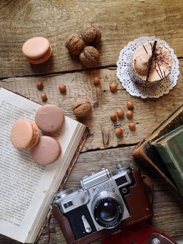 Macaroons, cake, nuts, old camera and books - бесплатный image #329101