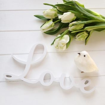 Tulips, word Love and toy bird on white background - бесплатный image #329291