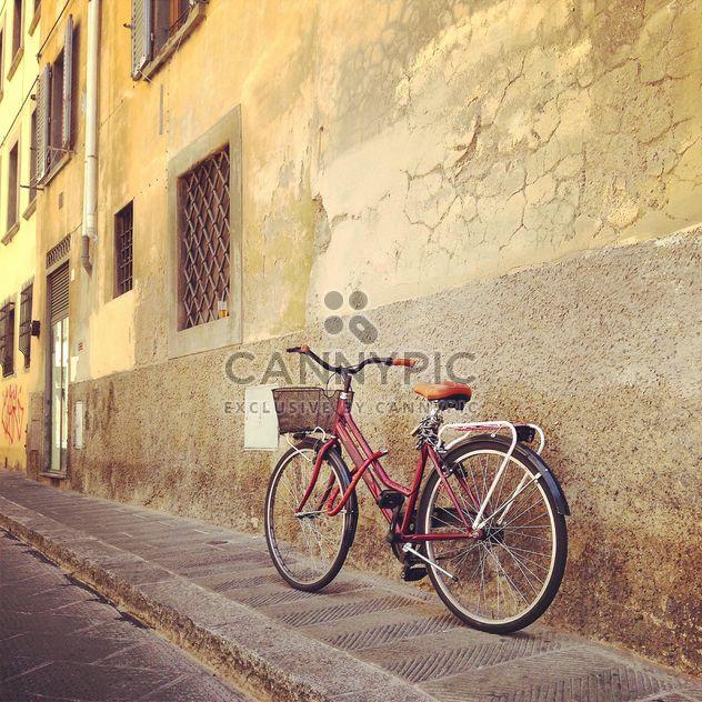 Red bike near house - Free image #331441