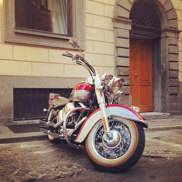 Motorcycle parked near house - Free image #331591