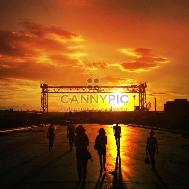 People in street at sunset - Free image #332881