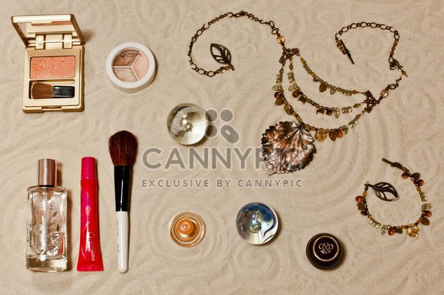 Cosmetic with the sands background - image gratuit #333231